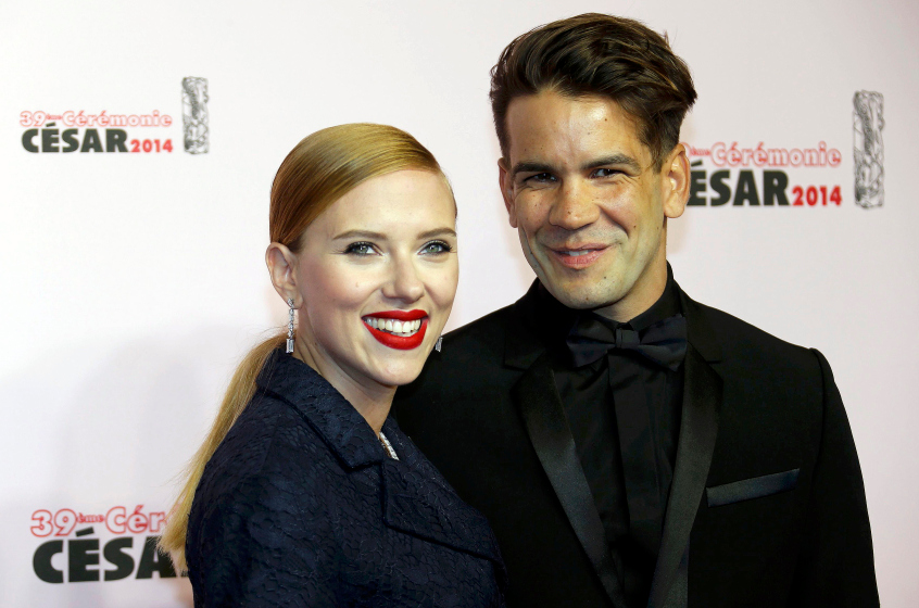 US actress Scarlett Johansson and her partner Romain Dauriac pose as they arrive for the 39th Cesar Awards ceremony in Paris