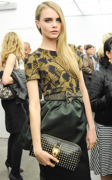 cara-delevingne-and-burberry-country-animal-studded-clutch-bag-gallery